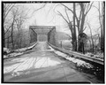 VIEW EAST SHOWING WEST PORTAL ELEVATION - Toelles Road Bridge, Spanning Quinnipiac River, Wallingford, New Haven County, CT HAER CONN,5-WALF,5-5.tif