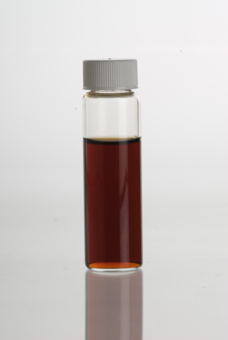 Vanilla extract - Vanilla extract in a clear glass vial