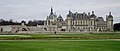 View of Chateau de Chantilly from Andre de Notre's French Garden (13041099185).jpg