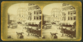 View of unidentified street with commerical businesses and traffic, from Robert N. Dennis collection of stereoscopic views.png