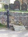 Village pump and mounting block - geograph.org.uk - 397388.jpg