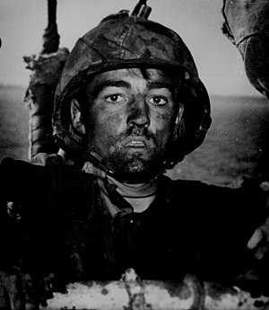 Battle of Eniwetok - An exhausted US Marine, Pvt. Theodore J. Miller, exhibits the thousand-yard stare after two days of constant fighting on Eniwetok. He was later killed in action at age 19 on March 24, 1944 at Ebon Atoll. He is buried at The Punch Bowl, HI