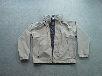 Lafuma - A Lafuma windbreaker with its hood stowed.