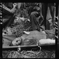 Wounded Pfc. Robison in stretcher on Guam after receiving blood plasma. - NARA - 520950.tif