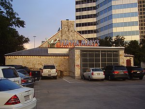 Photograph of a building's exterior from a parking lot