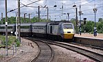 An East Coast HST set, tailed by 43257, departs York with a northbound service.