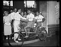 """In a bicycle built for two,"" Washington, D.C. September 8. Dr. Loo S. Rowe greets Victor Scarraffia and Vincente Gregori ? (front to rear) two Argentinian cyclists who left Buenos Aires LCCN2016878424.jpg"