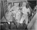 """Relaxing aboard a U.S. Coast Guard-manned transport headed for Pacific invasion areas, three Negro Marines catch a smok - NARA - 513196.tif"