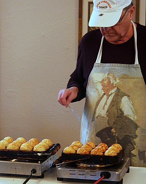 Æbleskiver - A man making æbleskiver at the Danish American Center in Minneapolis, Minnesota