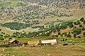 عشایر بختیاری در مسیر کوچ و در دور دست یک روستا Bakhtiarys in Zagros mountains - panoramio.jpg
