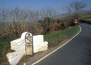 11th Milestone, Isle of Man - The 'Garrow' metal 13th Milestone on the A3 Castletown to Ramsey Road at the 11th Milestone ('Drinkwater's Bend').