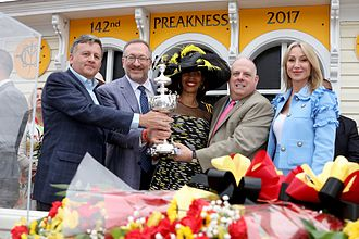 Cloud Computing (horse) - The owners of Cloud Computing pose with the Governor of Maryland and the Woodlawn Vase after winning the Preakness Stakes.