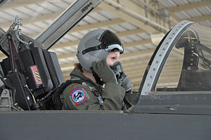 150408-F-IJ798-085 Lt. Kinder McCullough, 435th FTS Female instructor pilot student, adjusts her mask and helmet during a pre-flight checklist before a training flight.JPG