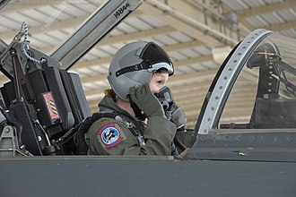 435th Fighter Training Squadron - A 435th Fighter Training Squadron instructor pilot student adjusts her mask and helmet before a training flight