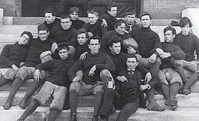 "Black & white image illustrating the fall 1892 to spring 1893 Agricultural and Mechanical College of Alabama, now Auburn University, varsity football team. On the football is written: ""93 Champions Ala & Ga."