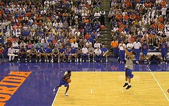 Joakim Noah - Noah during Midnight Madness with Sha Brooks during a 3-point shootout (October 13, 2006)