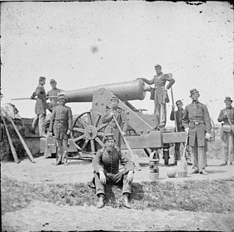 Fort Corcoran - Artillerymen pose with their 24-pounder siege cannon at Fort Corcoran