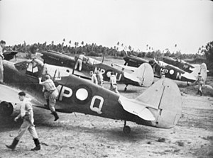 Members of No. 86 Squadron RAAF about to take off in their Kittyhawk fighters at Merauke in April 1944