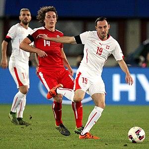 Josip Drmić - Drmić holding off Austria's Julian Baumgartlinger in a November 2015 friendly