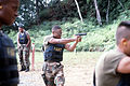 A Marine with M9 9 mm pistol engages a target on a combat pistol course DM-ST-90-02845.jpg