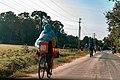 A Woman Riding a bicycle at Bagamoyo.jpg