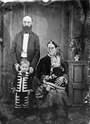 A group including a man, a woman and two children NLW3364662.jpg