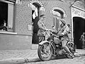 A motorcycle despatch rider delivers a message to the signals office of 1st Border Regiment at Orchies, France, 13 October 1939. O129.jpg