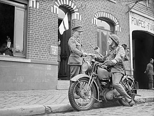Despatch rider - A despatch rider delivers a message to the signals office of 1st Border Regiment at Orchies, France, 13 October 1939