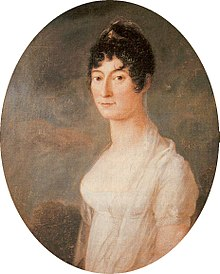 Formal portrait, half length, of a young, dark haired woman; her hair is plaited around her head, with curls framing her face. She is wearing a diaphanous shawl around her shoulders, over a short-sleeved gown which shows a great deal of decolletage.