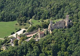 A 2012 aerial view of Rötteln Castle in ruins. There are two parts to the castle, each surrounded by a wall and each at different elevations.
