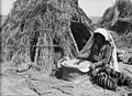 Agriculture, etc. Primitive methods of rubbing and grinding wheat. Woman grinding with present-day hand mill. Before her modest home on southern Sharon LOC matpc.15642.jpg