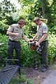 Alex & Christ digging a post hole (5891583464) (2).jpg