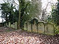 All Saints church in Snetterton - headstones in a tidy row - geograph.org.uk - 1762878.jpg