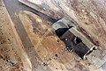 An aerial view of a destroyed aircraft hangar in the aftermath of Operation Desert Storm - DPLA - 623e1c3ca90e3181455e5cdc7b3f4604.jpeg
