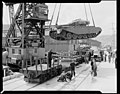 Army centurion tanks unloaded from ship to UD wagons.jpg