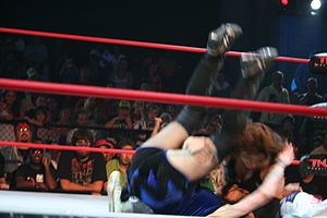 Professional wrestling throws - Ayako Hamada performing a Michinoku Driver II on Daffney.