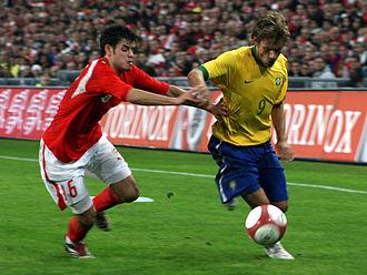 Tranquillo Barnetta - Barnetta challenging Rafael Sóbis in a friendly against Brazil in 2006