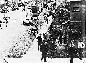 Battle of Ballantyne Pier - Mounted police chasing protestors through Vancouver's East End during the Battle of Ballantyne Pier.