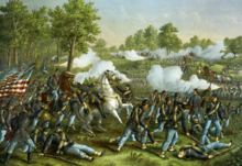 A painting depicting an American Civil War battle. In the foreground soldiers in blue surround a high-ranking officer on a white horse. The officer has been shot and is falling into the arms of one of the soldiers. They are fighting another group of soldiers who stand in the background wearing grey uniforms and firing weapons.