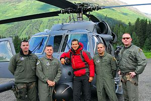 Man vs. Wild - Grylls in front of an Alaska Air National Guard helicopter before heading out to Spencer Glacier to film Man vs. Wild