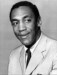 A black and white image of comedian Bill Cosby, who portrays Clair's husband Cliff.