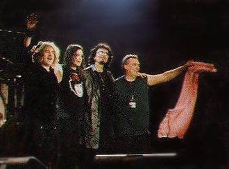 Black Sabbath - Black Sabbath on stage in Stuttgart on 16 December 1999, L-R: Butler, Osbourne, Iommi, Ward