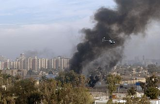 A Blackwater Security Company MD-530F helicopter aids in securing the site of a car bomb explosion in Baghdad, in December 2004, during the Iraq War. Blackwater Security Company MD-530F helicopter in Baghdad, 2004.JPG
