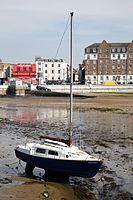 Boat at low tide in the harbour of Margate Kent England 1.jpg