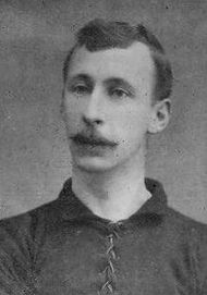 A man wearing a football shirt.