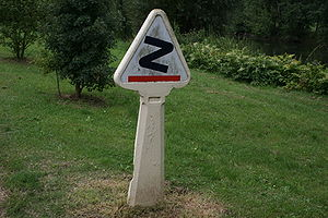 "Bourbaki dangerous bend symbol - French ""virages dangereux"" road sign, before 1949."