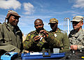 Botswana Defence Force Cpl. Ditebogo Raiye, center left, with the Corps of Engineers, checks the chlorine levels in the water with the assistance of U.S. Army Spc. Gerlado Godina, right, a water purification 120808-Z-VI159-023.jpg