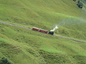 Mountain railway - Brienz Rothorn Bahn ascending Brienzer Rothorn in the Swiss Alps