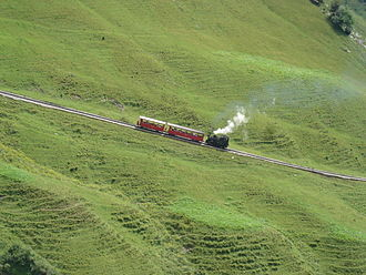 Mountain railway - Brienz Rothorn Bahn ascending Brienzer Rothorn in the Swiss Alps