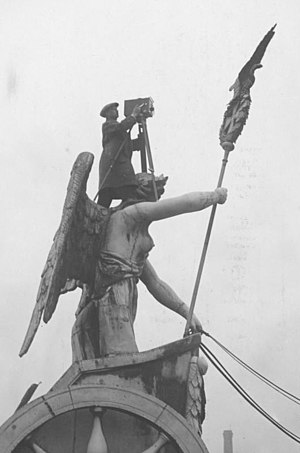 Camera operator - A camera operator on top of Brandenburg Gate in 1926